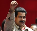Venezuela's VP Maduro greets supporters during a rally in Caracas